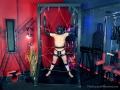 Bondage-frame-torment-handjob-01.jpg