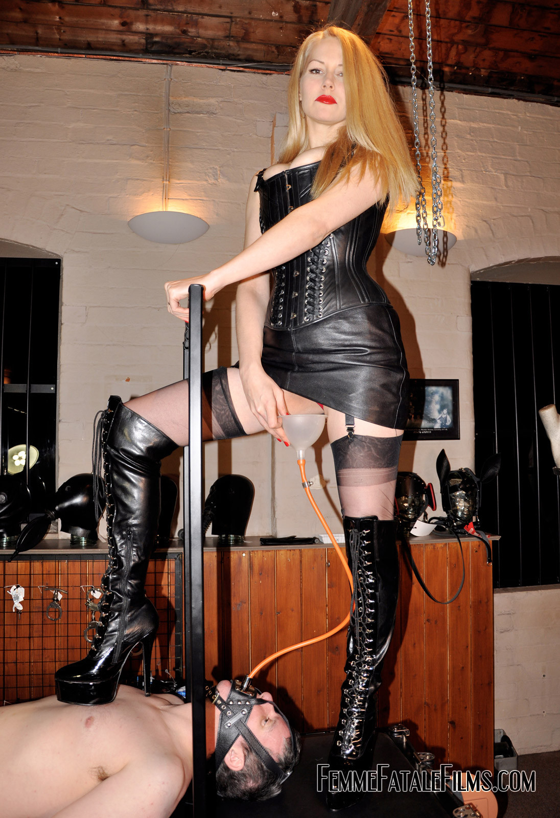 Japanese domme in latex punishes her male slave 5